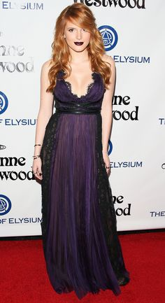 BELLA THORNE matches her dark purple lipstick exactly to her lace Marchesa gown at the Art of Elysium HEAVEN Gala.