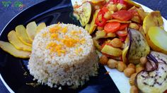 A vegan Moroccan dish of vegetables, chickpeas and quince roasted with Moroccan spices on a bed of fluffy citrus-aromatic bulgur. Moroccan Dishes, Moroccan Spices, Delicious Vegan Recipes, Roast, Dinner, Vegetables, Food, Bulgur, Yummy Vegan Recipes