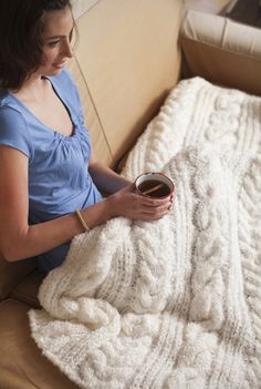 This pattern is a combination of knit & crocet. Very pretty! [First Frost Blanket | Crochet Today]