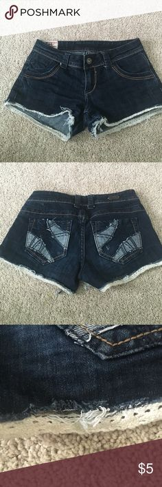 Denim and Lace Shorts These denim shorts have a white lace detail at the hem to give them a pop compare to other jean shorts. The lace is slightly pulled from the shorts on the back right leg as shown in the third picture, but it can be easily repaired. 1st Kiss Shorts Jean Shorts