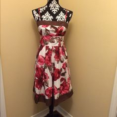 """Beautiful Floral Summer Dress Beautiful Floral Summer Dress. Pink/White/Brown. Size: 9. 30"""" (L) 100% cotton. Super cute flowing dress with adjustable shoulder straps & tie waist. Front pockets. Back zipper closure. Flowy, cool, & cute for any occasion. Never worn. Dresses Midi"""