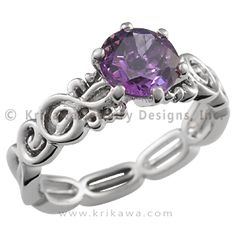 Harmony Treble Clef Engagement Ring with Amethyst - Does your heart sing with love and joy? Show it with this unique piece of music-themed jewelry. The center diamond or gemstone is prong-set between a pair of treble clefs. This design can accommodate your preferred stone shape and size. The rest of the band consists of a simplified music staff, divided into five segments. This artistic engagement ring tapers from 5 mm at the top to a narrow 3 mm at the bottom. Order this ring in platinum…