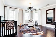 Child's room with dark crib and cowhide rug