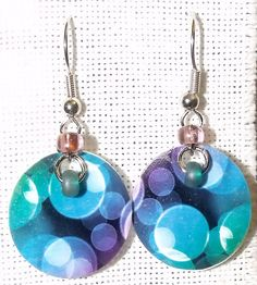 I made myself these earrings with printable shrinky dinks. The beads are purple and teal. Sorry for the bad photo!
