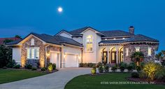 The Massimo is an enchanting manor that brings forth a European Tuscan flair. Floor plan has 4394 SF of living area, six bedrooms, four and 1/2 bathrooms.