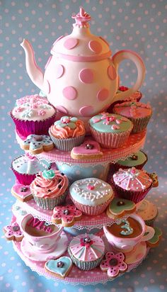 Teapot cake with tiers of cupcakes and cookies by nice icing, via Flickr
