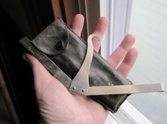 tiny folding travel coat hanger