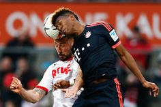 David Alaba of Bayern Muenchen challenges for the headed ball with Dominic Maroh of koeln during the Bundesliga match between 1. FC Koeln and FC Bayern Muenchen held at RheinEnergieStadion on March 19, 2016 in Cologne, Germany.