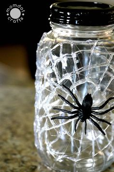Spider Web Mason Jars: DIY - - Halloween Mason Jar Craft DIY Idea: Spooky Mason Jar decor done in 5 minutes or less, Creepy Spider - Wine Bottle Crafts, Mason Jar Crafts, Mason Jar Diy, Halloween School Treats, Halloween Crafts, Halloween Halloween, Halloween Masquerade, Diy Home Decor Projects, Diy Projects To Try