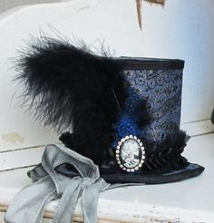 Brocade Skull Cameo Mini TopHat with Rhinestones Feathers and Silk. $65.00, via Etsy.
