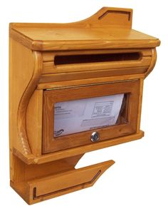 This mailbox is handmade of fir wood and is hand painted, and then finished with several coats of varnish. This is perfect for any types of weather. Mailbox is of Puritan Pine Color. Ideal for letters, newspapers and magazines with a window of forward. Includ two keys. Outside sizes are: 15,3''H x 12,8''W x 4,5''D This mail box is perfect for the person that gets a lot of mail or packages.