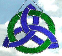 "Blue & Green Trinity Knot Stained Glass Suncatcher - 8"" x 8"" - $31.95 --- Celtic Designs, Irish Designs, Irish Sun Catchers - Glass Suncatchers, Stained Glass Décor, Stained Glass Sun Catchers -  Stained Glass Design - See more stained glass designs at www.AccentonGlass.com"