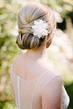 Chic Chignon - 5 New Bridal Hairstyles You'll Want to Pin Immediately - Southernliving. This classic bun is sleek and sophisticated. Dress it up with a seasonal bloom or ornamental hairpiece.