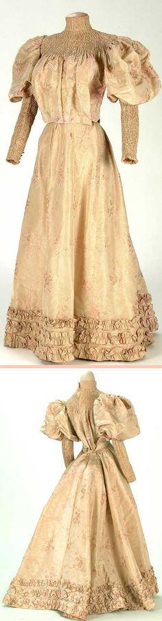 Dress, ca. 1895-1900. Jacquard floral print. Chest, neckline, and sleeves have tight smocking. Lined with pink silk taffeta with reinforced seams. Flared skirt is shown here with an S-shaped bustle. Textile Museum and Documentation Center of Terrassa (IMATEX)
