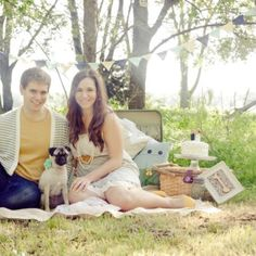 One year anniversary photo. Love the idea of throwing a blanket down on the grass with a picnic basket.