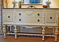 Grungy old Eastlake buffet picked from trash - restored by painting with Old Ochre and Old White for trim, Minwax Jacobean on top.