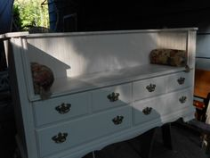 This old tired Dresser has a new live. It has become a seating bench with 4 drawers. Great for a entry, girls bed room, or porch bench too.