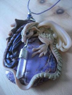 VEIL'S GIFT - ooak dragon pendant on jasper with dangling quartz crystal Polymer Clay Dragon, Polymer Clay Jewelry, Fimo Clay, Fantasy Dragon, Dragon Art, Dragon Head, Clay Projects, Clay Crafts, Biscuit