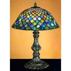 Features: -Bell shade. -Fishscale pattern. -Versatile accent lamp to complement any color or style. -Mahogany bronze hand finished lamp base. Fixture Finish: -Mahogany bronze. Fixture Material: