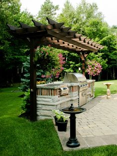 Arbor covered outdoor kitchen
