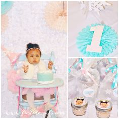 Winter ONEderland first birthday party by Frosted Events www.frostedevents.com  First birthday girl with her smashcake!  High chair bunting-- Pretty pastel winter theme dessert table, snowflake cookies, pink and turquoise blue cake pops #firstbirthday #winterwonderland #wintertheme #girlsbirthdayparty #birthday