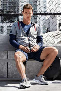 Take a breather in this gray zip-up sports jacket with mesh-lined drawstring hood, side pockets & double sleeves.   H&M Sport