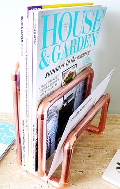 Mail organiser, letter rack made from plumbing, industrial copper pipe and fittings. Perfect for magazines to be stored at the rear of the rack and letters in the other two slots. Can be used as a stylish, useful ornament on your hallway table, or on your desk for tidying away that paperwork/mail. It can also be used for exhibiting leaflets/promotional pamphlets. The copper has been waxed, it will tarnish with age. If this is not the desired effect it can be cleaned with brasso or...