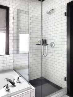 Love the white subway tiles with grey grout and grey floor tiles, glass door, and clean lines