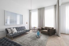 Clean scandi-style apartment located in Vienna, Austria, designed by Destilat. Old Building, Scandi Style, Design Studio, Neutral Colors, Window Treatments, Tile Floor, Modern, Architecture Design, Couch