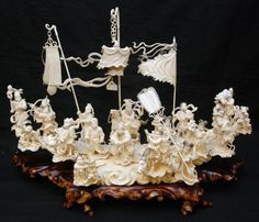 "An large and impressive Chinese hand carved ivory group depicting an interpretation of the 'Battle of Zhuolu'. Scene depicts 21 warriors, archers, infantry, General, women and children. The figures are standing on a cloud form ivory ground. Includes fitted cloud form wooden base. Measures 15 1/2"" height x 27"" length x 7 1/2"" depth + 2 3/8"" base height"