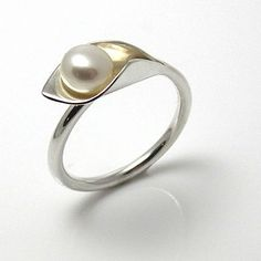 gorgeous silver and white pearl 'calla lily' ring.  add a couple of thousand to get it in platinum :/