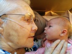 """First-time-father Scott Martin shared this photo of his 2-day-old daughter Penelope and her great-grandmother Millie on what would have been his grandparents' 71st wedding anniversary. Martin's grandfather, a WWII vet, passed away in August. When he saw how his grandmother and newborn baby looked at one another, he told BuzzFeed """"it was like they knew each other""""."""