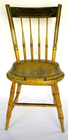 Signed S. Kilburn Painted Windsor Chair »  Circa 1840-1850: Stephen Kilburn was born in Massachusetts in the early 1800s where he learned the trade of chair joiner. This signed Kilburn side chair retains its original green, gold, and mustard paint decoration. This rare Ohio windsor remains in sturdy, usable condition and will make an excellent addition to any collection of painted furniture.