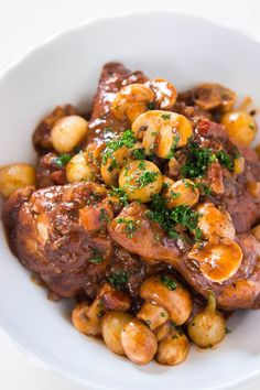 Coq au Vin~This yields fall-off-the-bone tender chicken, with perfectly cooked mushrooms and onions smothered in a rich sauce with depth that you just wouldn't expect in a chicken dish. I love having coq au vin over a bed of creamy mashed yukon gold potatoes!