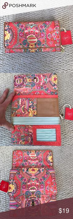 NWT OILILY wallet. NWT OILILY wallet. Large wallet with separate zipper coin compartment. main compartment has a flap closure with 2 press snap buttons, 11 credit card inserts, a place for a check book so many hiding places. Wipeable fabric. 7 1/4 long. Super cute pattern. Oilily Bags Wallets