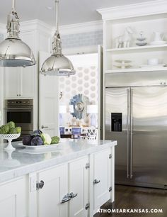 Love the open shelving above the fridge! Nobody can ever reach those cabinets without a stool, so you might as well show off some decorative pieces