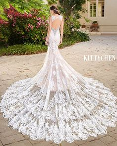 .This gorgeous creation from Kitty Chen Couture's 2016 Collection is too stunning! #lace #omgsopretty #longtrain #weddingdress #backless #weddinggown.