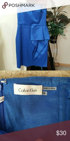 Calvin Klein cocktail dress Strapless Calvin Klein dress, I think the color is royal blue. Very beautiful, wore once for a wedding. Can wear to homecoming, very comfortable material is stretchy. Size 10 Calvin Klein Dresses Strapless