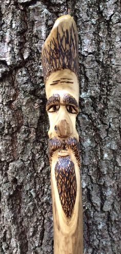 Wood Spirit hiking stick. Walking stick - Hand carved with pyrography. My work. First Wood Spirit I ever carved