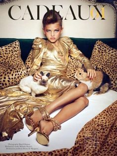 """This """"model"""" for French Vogue, Thylane Loubry Blondeau, is 10 years old. FREAKING TEN. This isn't just a little girl trying on mom's makeup and polish and heels. This is a child being photographed like an adult, in poses that scream """"sex"""". Oh, and the worst part, IMO? The model's so-called mother responded to the controversy by saying that """"bad people"""" [sic] in the US are stirring this controversy out of nothing because of our """"uptight culture"""". Well, excusez moi, but fuck you."""
