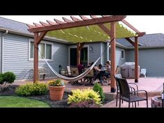 Add extra shade and style to your outdoor living space with a wire-hung canopy system. These billowing shades easily slide on the cables they hang from so you can have shade when you want it and retract them when you want a little more sun.