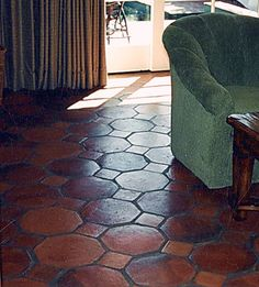 terra cotta tile floor- would be great on the patio