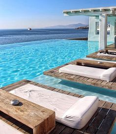 How relaxing does the  @cavotagoomykonos pool look?!   It's been fun but now off to the next destination. Tag someone you'd like to swim here with   #cavotagoomykonos . Mykonos , Greece