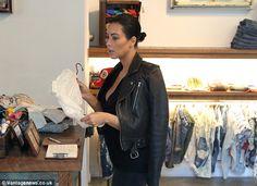 Neutral: Kim chose a white coloured onesie...