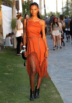 Jasmin Tookes in a fringe dress and black ankle boots // Coachella 2015