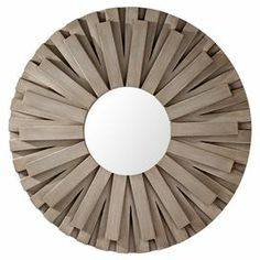 "Showcasing a discus-inspired geometric silhouette and antique silver leaf finish, this eye-catching wall decor is perfect as part of your living room gallery wall or displayed on its own in the foyer.   Product: Wall DecorConstruction Material: Wood frame and glass leafColor: Antique silverDimensions: 36"" Diameter"