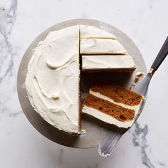 Pumpkin Layer Cake with Mascarpone Frosting | This classic pumpkin cake from Food & Wine's Justin Chapple is perfectly moist and delicately spiced. The simple vanilla buttercream frosting gets a lovely tang from the mascarpone that's blended in.