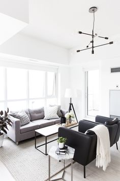Spotted: The Mobile Chandelier in Black in blogger, Stephanie Sterjovski's monochrome living room