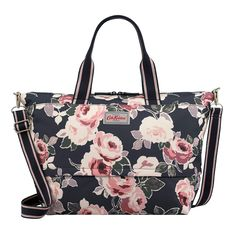 An expandable travel bag perfect for holidays. The back strap allows the bag to be hooked onto a suitcase. Light travel wear in the Paper Rose pink floral pattern.