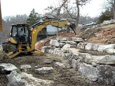Dirt Pro on Caterpillar 420E Backhoe - Building boulder retaining walls - YouTube